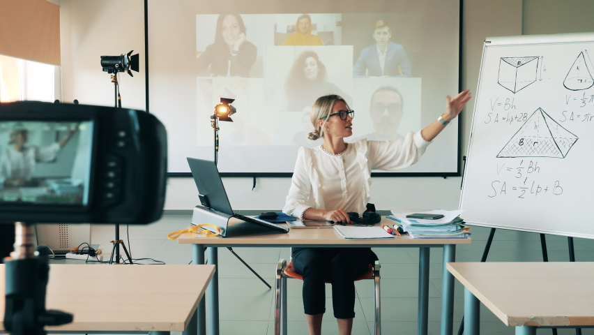 Maths teacher is having an online lesson with adult students Royalty-Free Stock Footage #1060240526