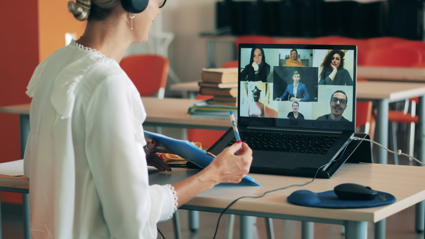 Adult students are taking part in the online lesson.   Shutterstock HD Video #1060240529