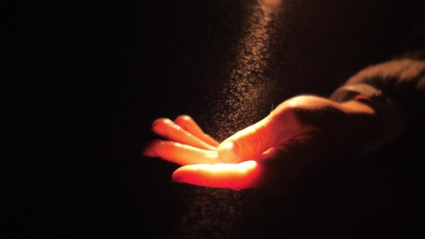 Human hand touching light particles in dark background. Fog mist shine in ray of light. God faith prayer meditation darkness night concept. Slow motion, 4K UHD | Shutterstock HD Video #1060293671