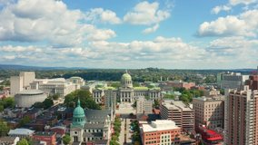 Aerial view of Harrisburg, Pennsylvania state capitol with slow camera approach towards its dome, along State street.