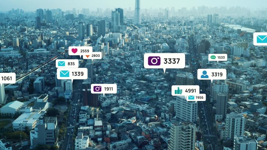 Notice balloons of social networking service pop-up above modern city. Social media. | Shutterstock HD Video #1060308158