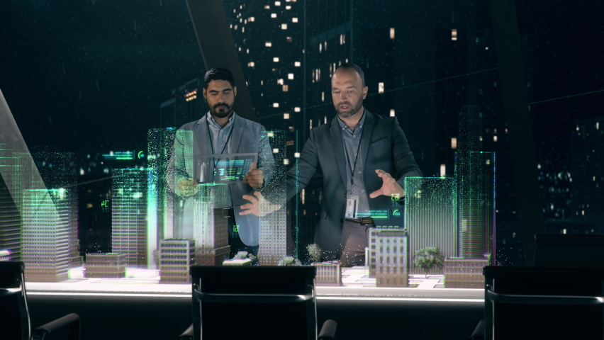 In the Near Future: Professional Designer in Suit Working on Architecture Project with Partner standing around Futuristic Table Using Holographic Modern Augmented Reality Technology. | Shutterstock HD Video #1060323413