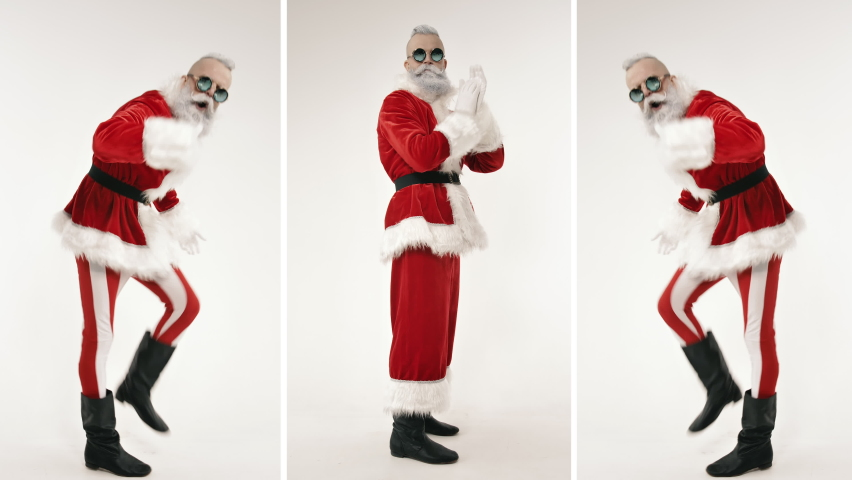 Energetic Active Dance of Emotional Excited Stylish Santa Claus Clapping Hands, Looking at Camera Indoor. Festive Mood on Positive Celebration of Happy New Year, Merry Christmas, Having Fun at Holiday