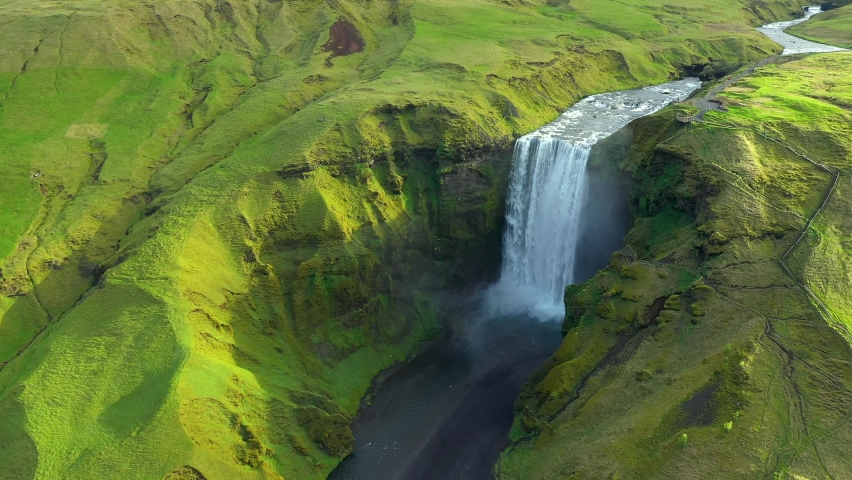 Skogafoss, Iceland's famous Ring Road waterfall. Aerial drone view of the magnificent natural wonder