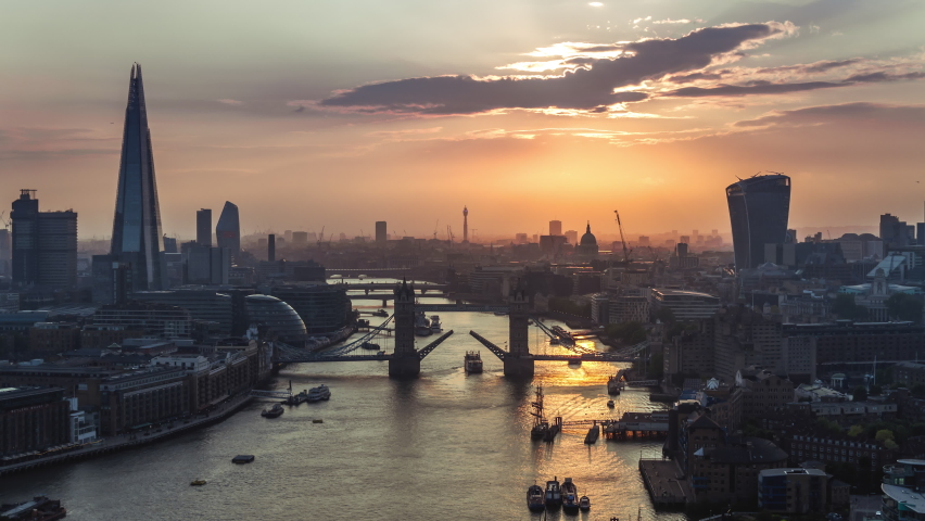 Open Tower bridge, Epic Sunset & Orange Light, Establishing Aerial View Shot of London UK, United Kingdom