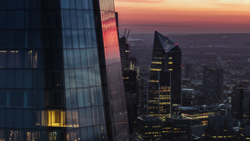 Cinematic Aerial View Shot of London UK, City of London in stunning red orange light, United Kingdom