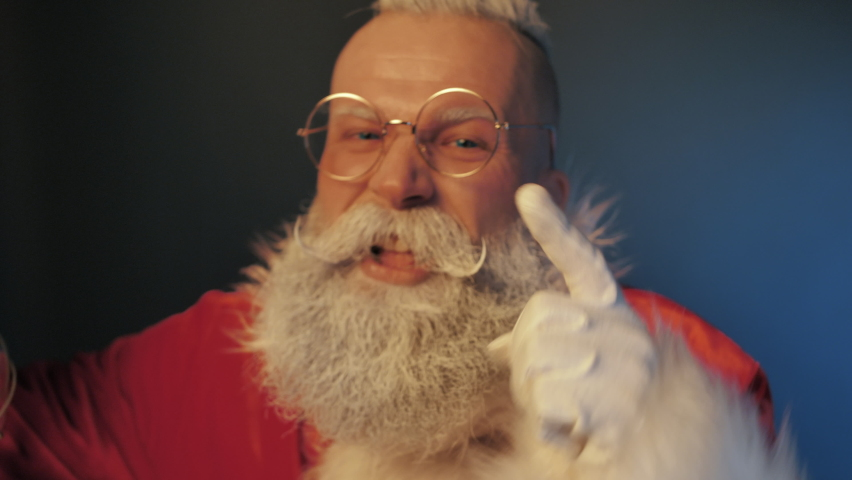 Negative Emotions of Angry Crazy Mad Screaming Santa Claus Swearing at Naughty Kid which will Not Receiving Holiday Gift for Behaved Badly all Year Closeup Indoors. Aggressive Furious Talk, Discontent | Shutterstock HD Video #1060350410