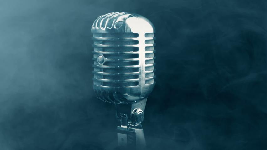 Vintage Microphone Rotating In Smoky Atmosphere | Shutterstock HD Video #1060359962