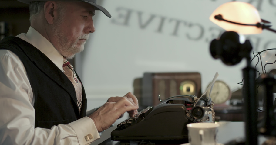 Scene pulls back to further reveal a film noir type private detective in his business office typing on a typewriter.