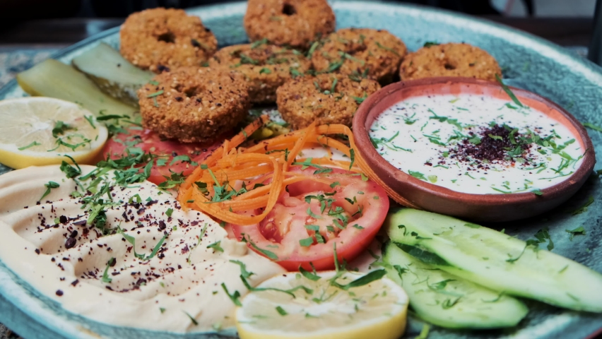Traditional lebanese vegan dish served with falafel side dish