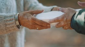 woman volunteer help feed the homeless with free meal. Close-Up. . High quality 4k footage