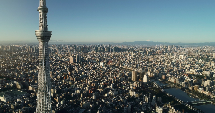 Flying over Tokyo skytree, Tokyo cityscape and Mt. Fuji in Japan | Shutterstock HD Video #1060407094
