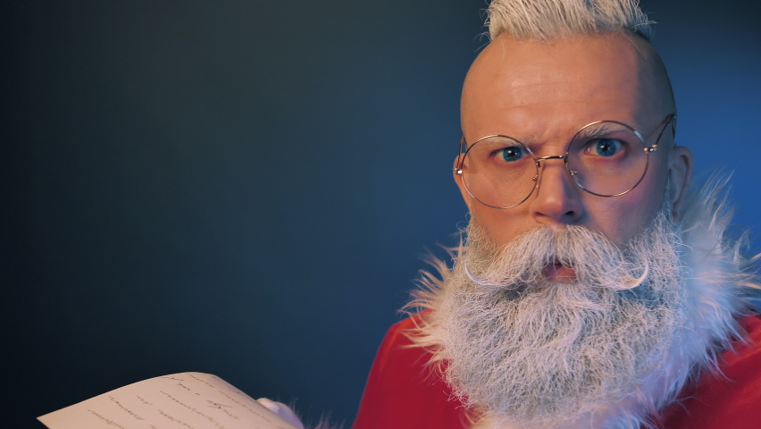 Surprised Reaction of Santa Claus Reading Wishes Letter using lantern lights, Checking Gift List of Kids Dreams Closeup Indoors. Festive Magic, Christmas Spirit, Traditional Preparing Before New Years Eve, Holidays Season | Shutterstock HD Video #1060416664