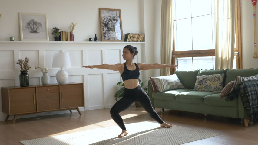 Young Woman Doing Meditation Exercise Stretching Sports Yoga, Clothes Black Leggings and tube Top, Bright Room at Home.   Shutterstock HD Video #1060427788