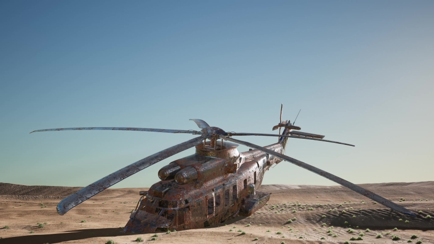 Old rusted military helicopter in the desert at sunset