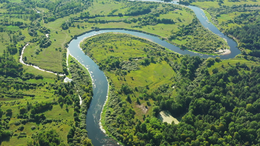 Aerial View Green Forest Woods And River Landscape In Sunny Summer Day. Top View Of Beautiful European Nature From High Attitude In Autumn Season. Drone View. Bird's Eye View.