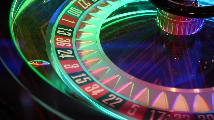 French style roulette table for money playing in Las Vegas, USA. Spinning wheel with black and red sectors for risk game of chance. Hazard amusement with random algorithm, gambling and betting symbol. | Shutterstock HD Video #1060475014
