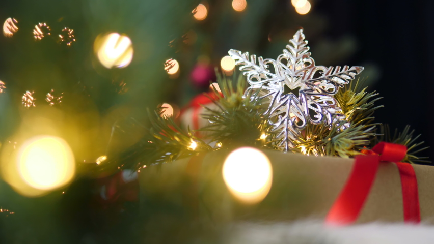 Christmas decoration with fir branches on gift box with shiny light. | Shutterstock HD Video #1060477579