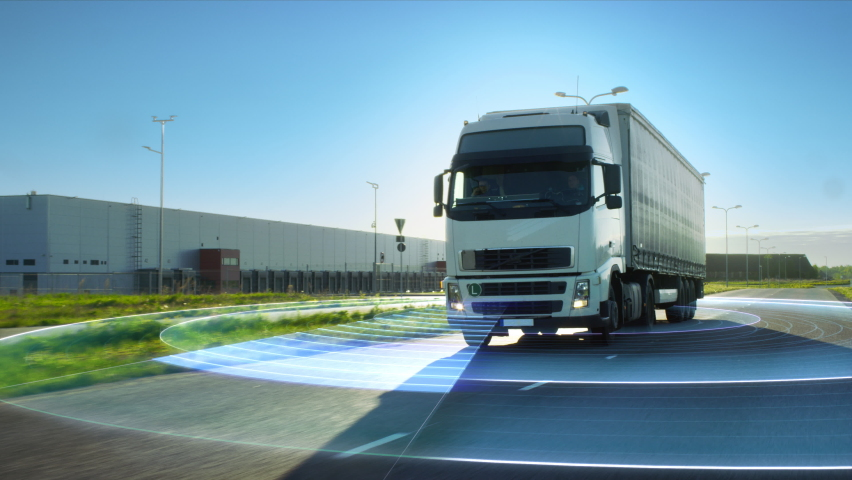 VFX Concept: Big Autonomous Semi-Truck with Cargo Trailer Drives on the Road with Concept Sensors Scanning Surrounding. Graphics and Special Effects of Futuristic Self Driving Truck Analyzing Freeway Royalty-Free Stock Footage #1060479034