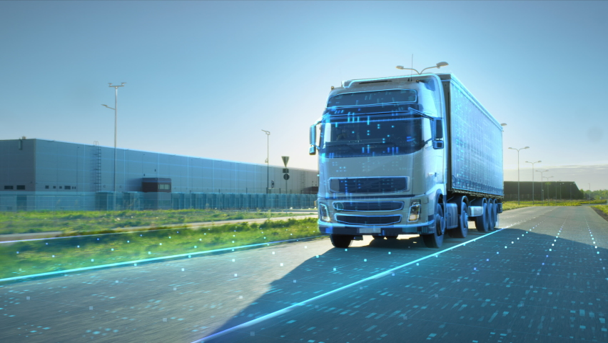 VFX Concept: Big White Semi-Truck with Cargo Trailer Drives on the Road is Transformed with Graphics and Special Effects Into Digitalized Version Digital Twin Futuristic Concept of Autonomous Vehicle Royalty-Free Stock Footage #1060479040