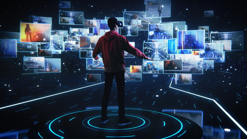 Internet Interface Concept: Person Sitting on Couch Puts on Virtual Reality Headset and Enters Cyberspace Internet Interface He Browses Web Content, Watches Video Streaming, Social Media | Shutterstock HD Video #1060479121