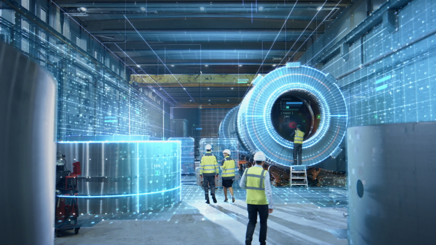 Futuristic Technology Concept: Team of Engineers and Professionals Workers in Industry Manufacturing Factory that is Digitalized with Graphics into Connected Automated Machinery.High-Tech Industry 4.0 Royalty-Free Stock Footage #1060479163