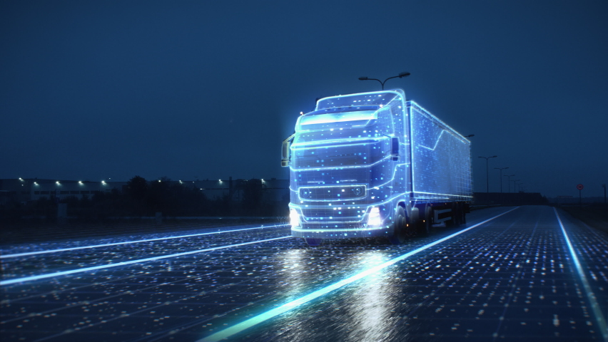 Futuristic Technology Concept: Autonomous Semi Truck with Cargo Trailer Drives at Night on the Road with Sensors Scanning Surrounding. Special Effects of Self Driving Truck Digitalizing Freeway