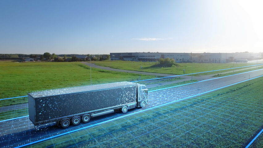 Futuristic High-Tech Concept: Big Semi Truck with Cargo Trailer Drives on the Road is Transformed with Graphics Special Effects Into Digitalized Advanced Autonomous Truck Concept. Aerial Drone Shot Royalty-Free Stock Footage #1060479190