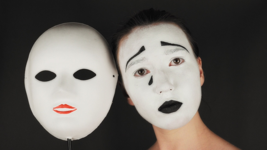 Portrait of a mime and bodypainting woman in white with black lips. Mime woman on black background.  Royalty-Free Stock Footage #1060511386
