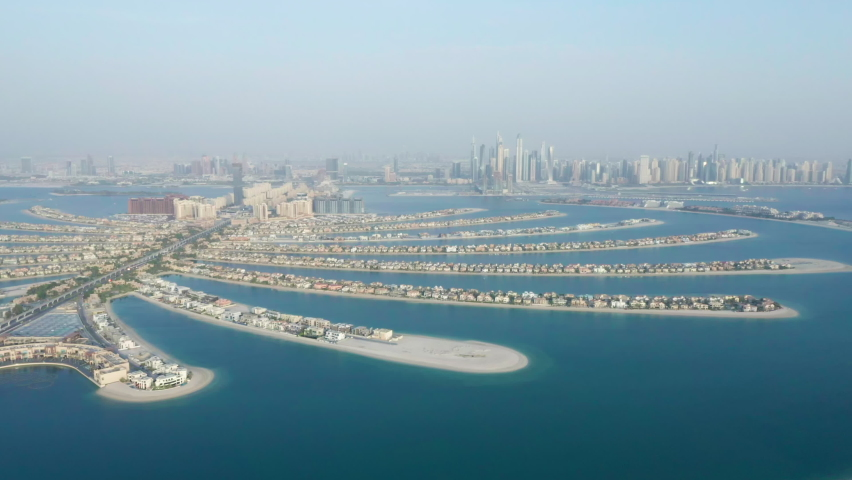 Aerial view of branches of Palm Jumeirah man-made islands in Dubai, United Arab Emirates (UAE) with luxury hotels, residences and tourist attractions Royalty-Free Stock Footage #1060519186