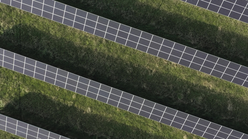 Top down flyover aerial shot of a big solar panel farm in southwestern Sweden, Scandinavia. Clean, green, sustainable energy production.   Shutterstock HD Video #1060526245
