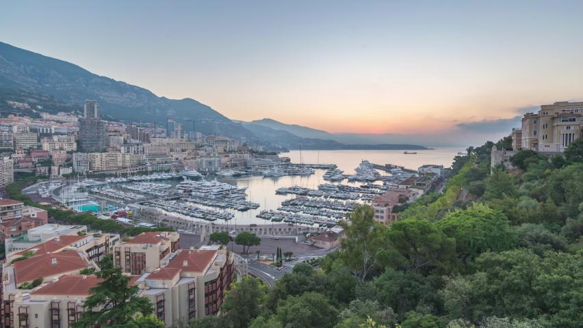 Monte Carlo Monaco time lapse 4K, city skyline night to day sunrise timelapse at Ville port