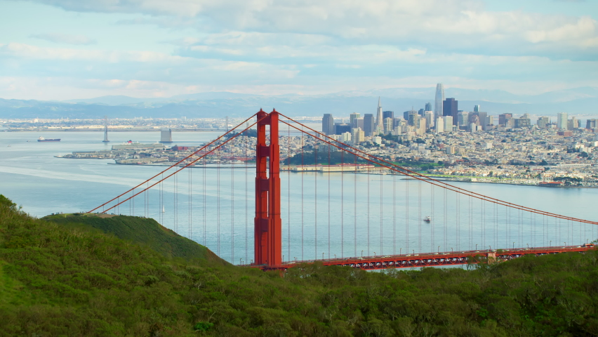 Flying over the Marin Headlands to discover the Golden Gate Bridge. San Francisco, US. This suspension bridge is one of the most iconic landmarks of California. Shot on Red weapon 8K.