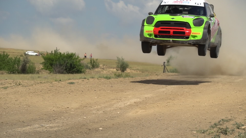 Rally car driving fast in cross-country road. Fast car is going with dust. Speed off-road riding on dusty road. Royalty-Free Stock Footage #1060547938