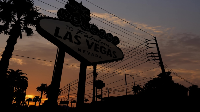 Famous Billboard at Las Vegas entrance,Time Lapse at Sunrise with Colorful Clouds, Nevada USA | Shutterstock HD Video #1060557436