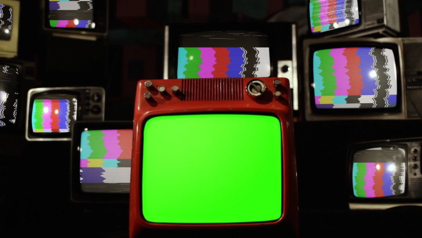 """Stack of Old TVs with Color Bars and Retro Red TV with Green Screen. Zoom In. You can replace green screen with the footage or picture you want. You can do it with """"Keying"""" effect in After Effects. Royalty-Free Stock Footage #1060571314"""