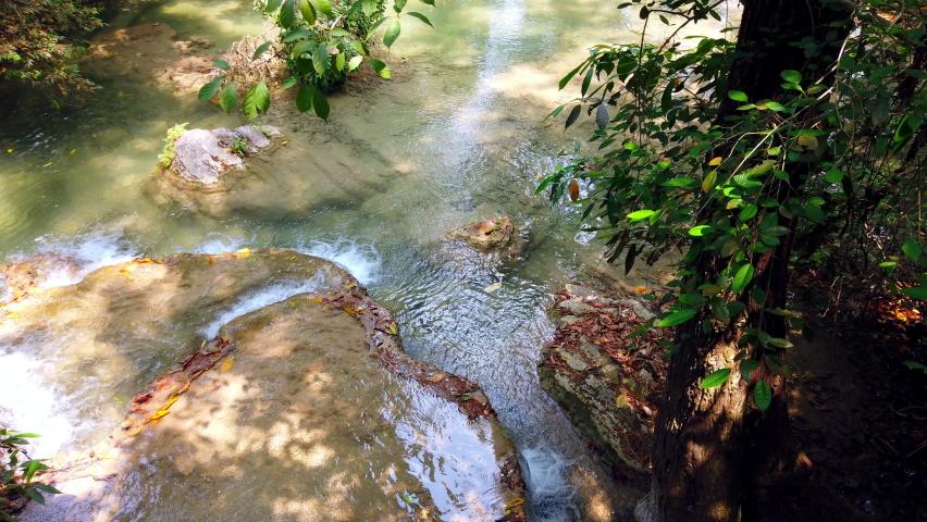 Erawan national park or Erawan waterfall at Kanchanaburi province in Thailand. travel vacation trip. 4K ultra HD.