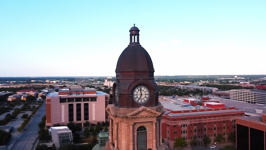 Around the Clock of the Tarrant County Courthouse. At first implementing a red heavy cityscape background, then revealing to the North, a view of the West Fork Trinity River in Fort Worth, TX.