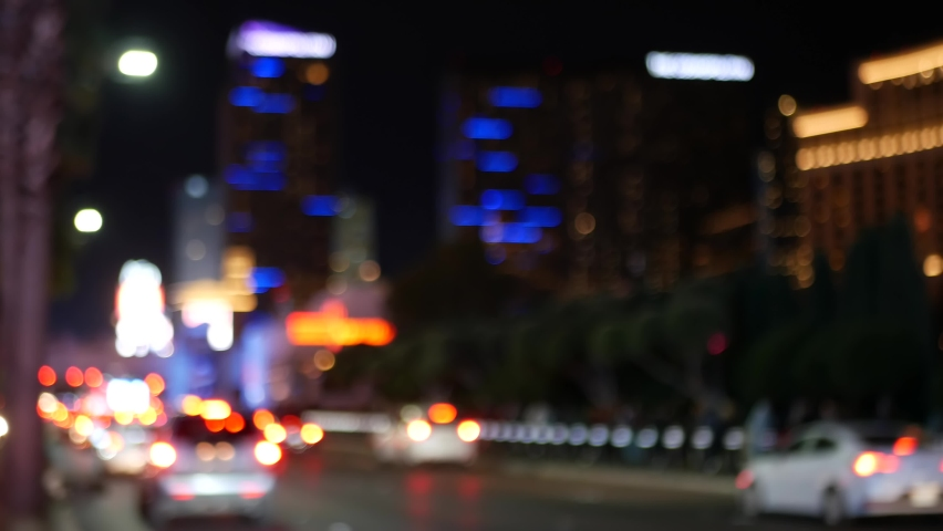 Defocused fabulous Las Vegas Strip boulevard, luxury casino and hotel, gambling area in Nevada, USA. Nightlife and traffic near Fremont street in tourist money playing resort. Neon lights of sin city. | Shutterstock HD Video #1060590169