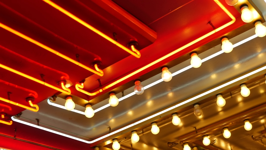 Old fashioned electric lamps blinking and glowing at night. Abstract close up of retro casino decoration shimmering in Las Vegas, USA. Illuminated vintage style bulbs glittering on Freemont street. | Shutterstock HD Video #1060590214