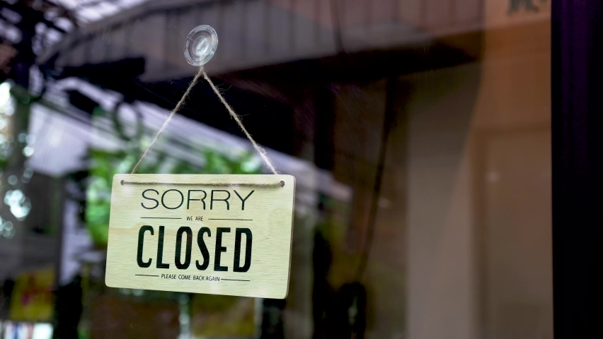 Business owner asian woman wear mask in apron hanging turning Welcome we are open sign on front glass door cafe. Reopening activity after COVID-19, ended the lockdown and quarantine.  | Shutterstock HD Video #1060590247