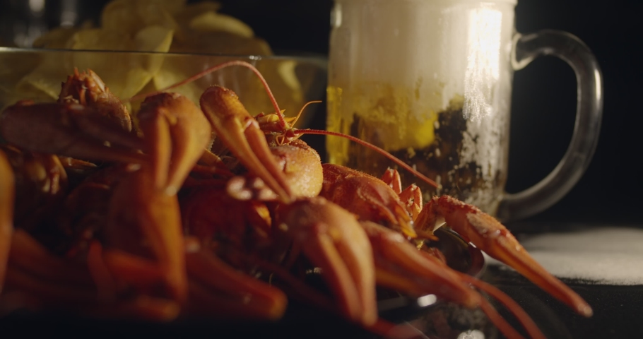 Close up view of lobsters with foamy bear and chips on background in slow motion | Shutterstock HD Video #1060609792