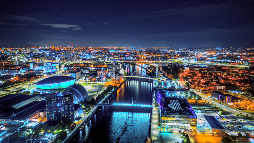 Glasgow city aerial at night over river Clyde