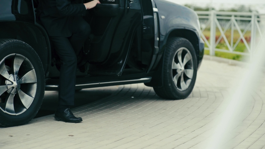 Secret service agents get out of the car. Close-up of the legs. Royalty-Free Stock Footage #1060640248