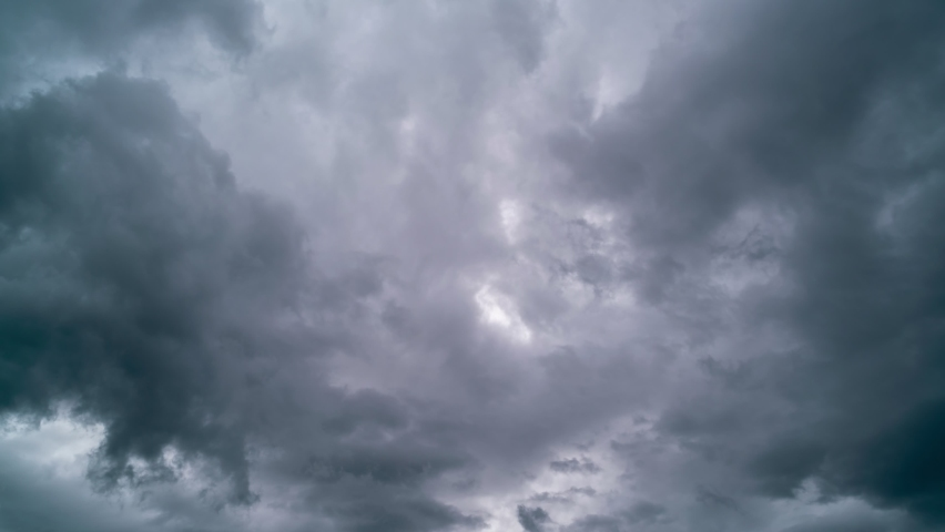 Time lapse 4K of moving dark rain storm clouds flowing in the sky in bad weather day,Horrible weather  | Shutterstock HD Video #1060648828