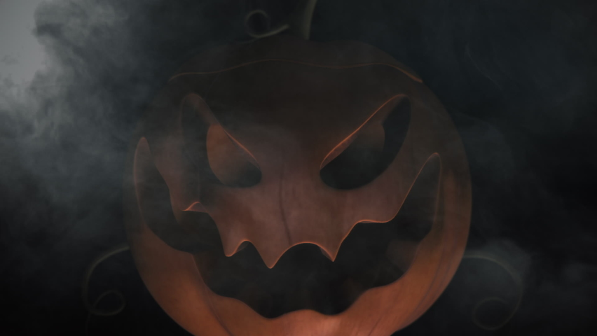 Animation of the appearance of a Halloween pumpkins from the darkness. Horror scene or Halloween decoration.   Shutterstock HD Video #1060655806