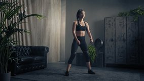 Slender figure of woman doing squat training. Healthy women in sportswear doing squat at home. Home fitness workout. Slow motion.