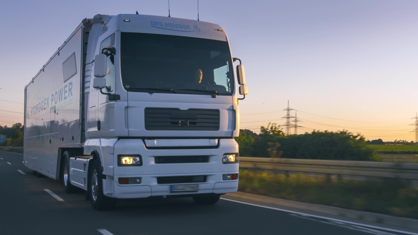 Hydrogen fueled truck on the road drinving. h2 combustion Truck engine for emission free ecofriendly transport.  | Shutterstock HD Video #1060675672