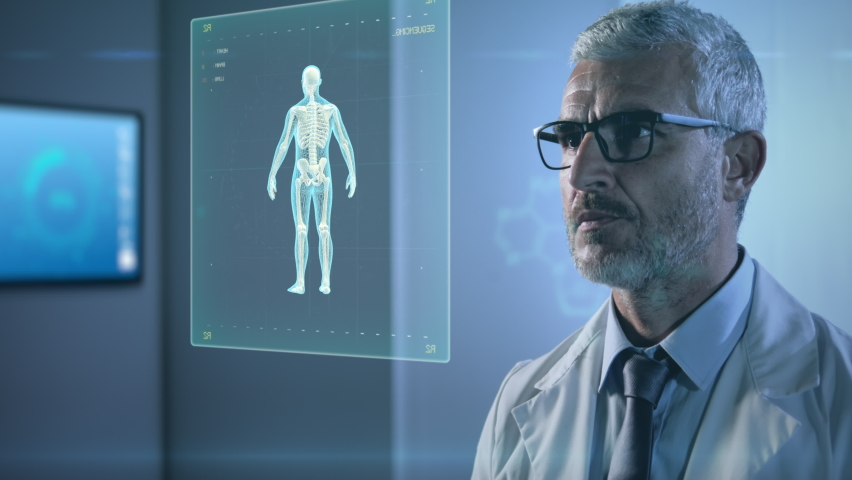 high tech futuristic hospital,man doctor working with augmented reality,scientist male in uniform examines 3d human body organs in laboratory with artificial intelligence Royalty-Free Stock Footage #1060685311