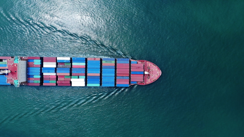 Aerial top view smart cargo ship carrying container running opposite directions for export import near  cargo yard port concept freight shipping by cargo ship . | Shutterstock HD Video #1060686865